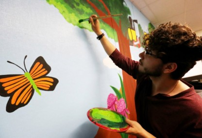 San Jacinto High School's Silverio Caballero, 17 helps paint a mural students designed at San Jacinto Preschool in San Jacinto Tuesday, Mar. 7, 2017. FRANK BELLINO, THE PRESS-ENTERPRISE/SCNG