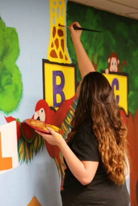 San Jacinto High School's Lindsey Tarvin, 17 paints part of the mural they designed at San Jacinto Preschool in San Jacinto Tuesday, Mar. 7, 2017. FRANK BELLINO, THE PRESS-ENTERPRISE/SCNG